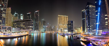 The night illumination of Dubai Marina. DUBAI, UAE - SEPTEMBER 8: The night illumination of Dubai Marina on September 8, 2013 in Dubai, UAE. It is an artificial Stock Images