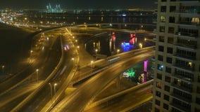 Night illumination dubai traffic downtown roof top panorama timelapse. Night light dubai traffic road timelapse. 4K stock footage