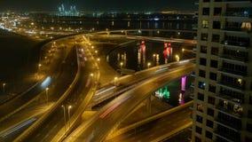 Night illumination dubai traffic downtown roof top panorama timelapse. Night light dubai traffic road timelapse. P Stock Photos