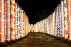 Night illumination of kimono fabrics along a garden path in Kyoto, Japan Stock Image