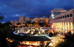 Night illumination of luxury hotel and clouds Stock Photography
