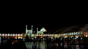 Night illumination on Nagsh-e Jahan Square, Isfahan. Nagsh-e Jahan Square is one of the most beautiful city locations in the evening, it boasts bright stock video footage