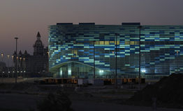 Night illumination of the Olympic Winter Palace of Sports Stock Photos