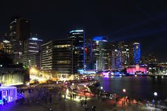 Night image of cityscape of Sydney at Circular Quay or Harbour in Australia. Long exposure shot of buildings illuminated for Vivid Sydney festival in 2018 royalty free stock image