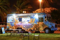 Night image of food trucks in a park 5. MIAMI BEACH, FL, USA - DECEMBER 26, 2017: Night image of a food truck gathering in Haulover Park kite field royalty free stock photos