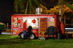Night image of food trucks in a park 3. MIAMI BEACH, FL, USA - DECEMBER 26, 2017: Night image of a food truck gathering in Haulover Park kite field stock photography