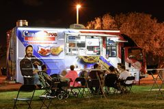 Night image of food trucks in a park. MIAMI BEACH, FL, USA - DECEMBER 26, 2017: Night image of a food truck gathering in Haulover Park kite field stock photos