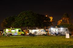 Night image of food trucks in a park. MIAMI BEACH, FL, USA - DECEMBER 26, 2017: Night image of a food truck gathering in Haulover Park kite field stock photo