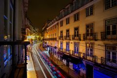 Street at night in Lisbon Portugal with motion blur stock image