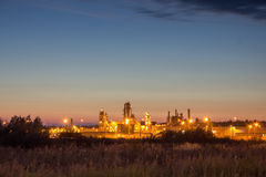 Night image of timber processing plant. Stock Photo
