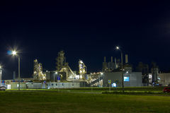 Night image of timber processing plant. Royalty Free Stock Image