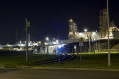 Night image of timber processing plant. Stock Images