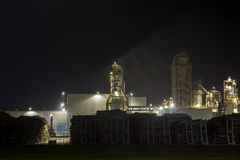 Night image of timber processing plant. Royalty Free Stock Images