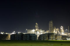 Night image of timber processing plant. Royalty Free Stock Photos