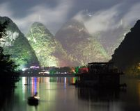 Night image of Yangshuo city near cloudy hill Stock Photos
