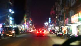 Night Indian street from window in the bus Kerala India Timelapse stock video footage