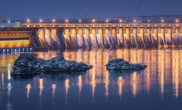 Night industrial landscape with dam hydroelectric power station Stock Photos