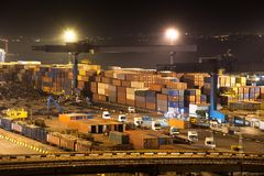Night industrial port. Containers and trucks royalty free stock photos