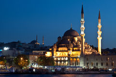 Night Istanbul. Istanbul skyline from Galata bridge by night, with Suleymaniye mosque and fish boat restaurants in Eminonu Stock Photo