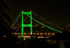 Green lights over the bridge. By night the Istanbul bridges over the bosphorus are illuminated in different colors. Green is one of my favorites Royalty Free Stock Images