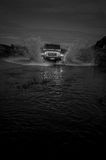 Night jeep river crossing Stock Photo