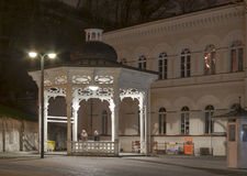 Night Karlovy Vary cityscape with Pramen Svoboda h Royalty Free Stock Image