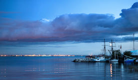 Night kind on city fires. Night kind on city fires, a water smooth surface and boats Stock Images
