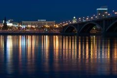Night Krasnoyarsk bridge over the Yenisei. Krasnoyarsk bridge over the Yenisei, night city lights reflected in the water Stock Images