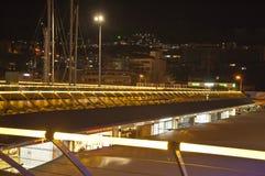 Night Kuasadasi. Kusadasi, Turkey - November 15, 2014: The Place for walking near the marina of Kusadasi. Toourist seson is over and people can hardly see Stock Photos