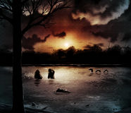 Night Lake. Mysterious silhouettes gather as the sun sets on a dark and spectacular lake Stock Photography
