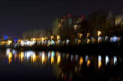 Night lake in the city, the reflection of the light of lanterns and street illumination lights. stock image