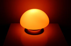 Night lamp. Lit nightlamp standing on a table Royalty Free Stock Photos