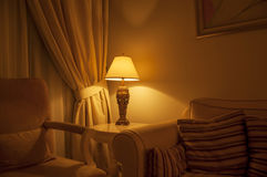 Night lamp. An ambient lighting in a classic living room Stock Image