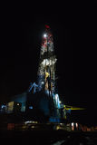 Night land drilling rig Stock Images
