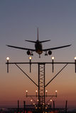 Night Landing. Of a commercial aircraft at the airport Royalty Free Stock Photo