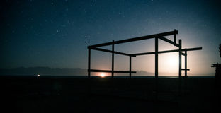 Night landscape. Frame construction on the backgrounf of night sky Stock Images