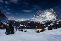 Night landscape, Austria. Night landscape of Austrian houses lit against mountains in snow Stock Photos