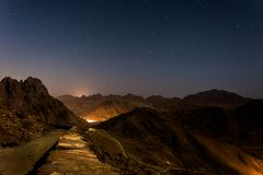 Night landscape, bald mountains against a starry sky stock photo