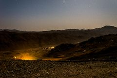 Night landscape, bald mountains against a starry sky royalty free stock photography