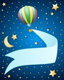 Night landscape with balloon and banner Royalty Free Stock Image