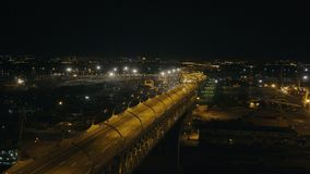 Night car traffic on city highway over construction site residential area. Night landscape car traffic on modern city highway road over construction site new stock video footage