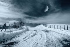 Night landscape in the countryside. Road in the night with snow and moon light Royalty Free Stock Photos