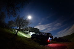 Night landscape on field and terrain car Royalty Free Stock Photo