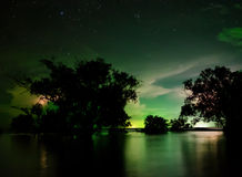 Night landscape with flare of lighting flashes, Thailand. Stock Photography