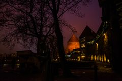 Night landscape of fortress walls with lighting. The Former Prison Tower Neitsitorn In Old Tallinn, Estonia. Maiden Tower. Night landscape of fortress walls with royalty free stock photo