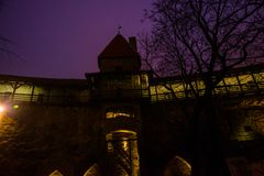 Night landscape of fortress walls with lighting. The Former Prison Tower Neitsitorn In Old Tallinn, Estonia. Maiden Tower. Night landscape of fortress walls with stock images