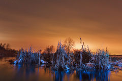 Night landscape in the frozen river. Royalty Free Stock Images