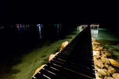 Night landscape of Koh Kood. Summer landscape on tropical koh Kood island  in Thailand. Landscape with sea and wooden pier taken from Bang Bao beach during night Stock Photography