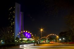 Night landscape on long exposure. Tall building and cars passing the night lights stock image