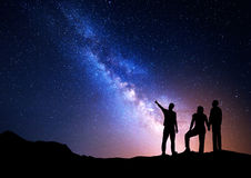 Night landscape with Milky Way and silhouette of a family Royalty Free Stock Image